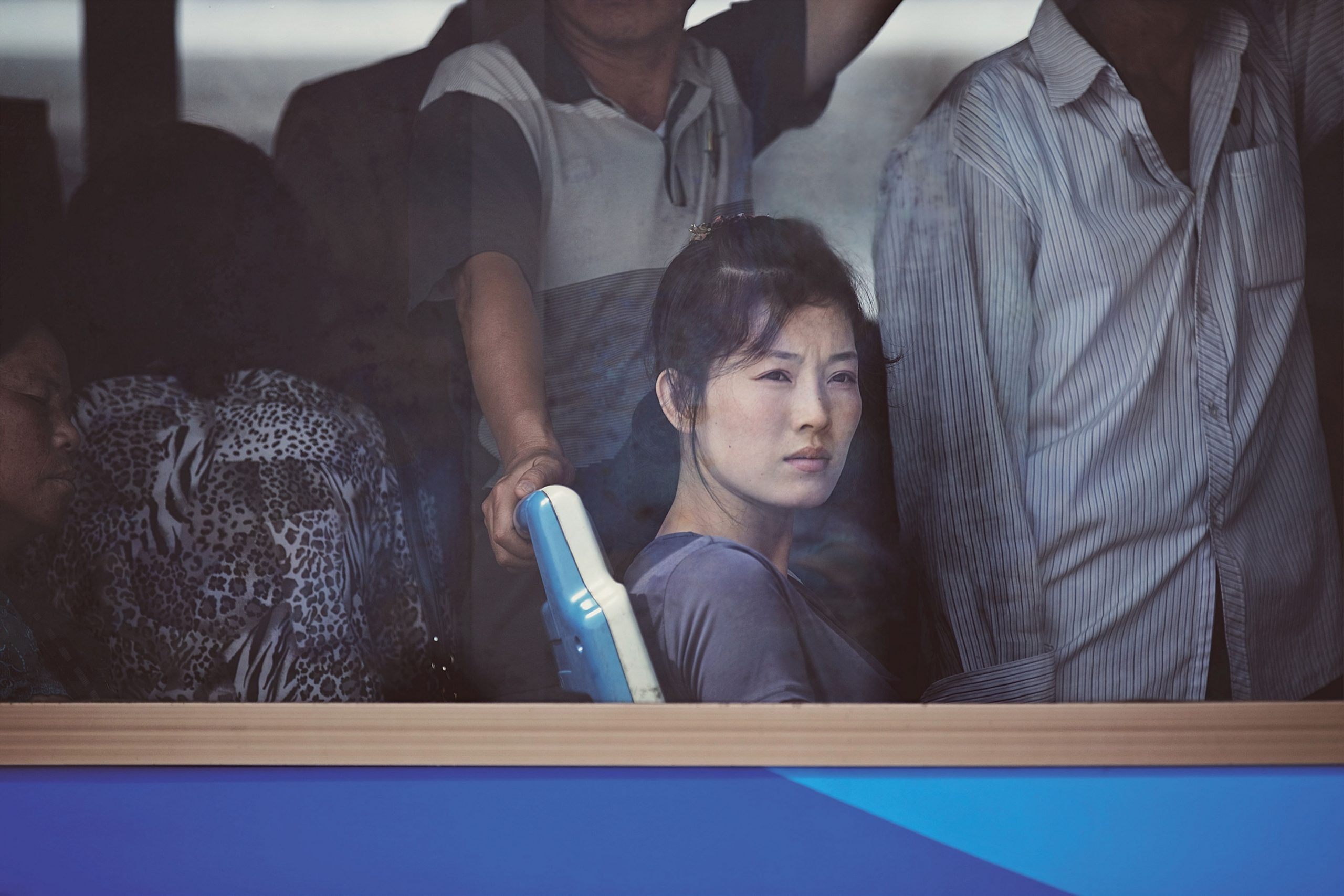 Xiomara Bender's 2015 photo 'Woman on a bus at a Bus  stop at Kim Il Sung Square