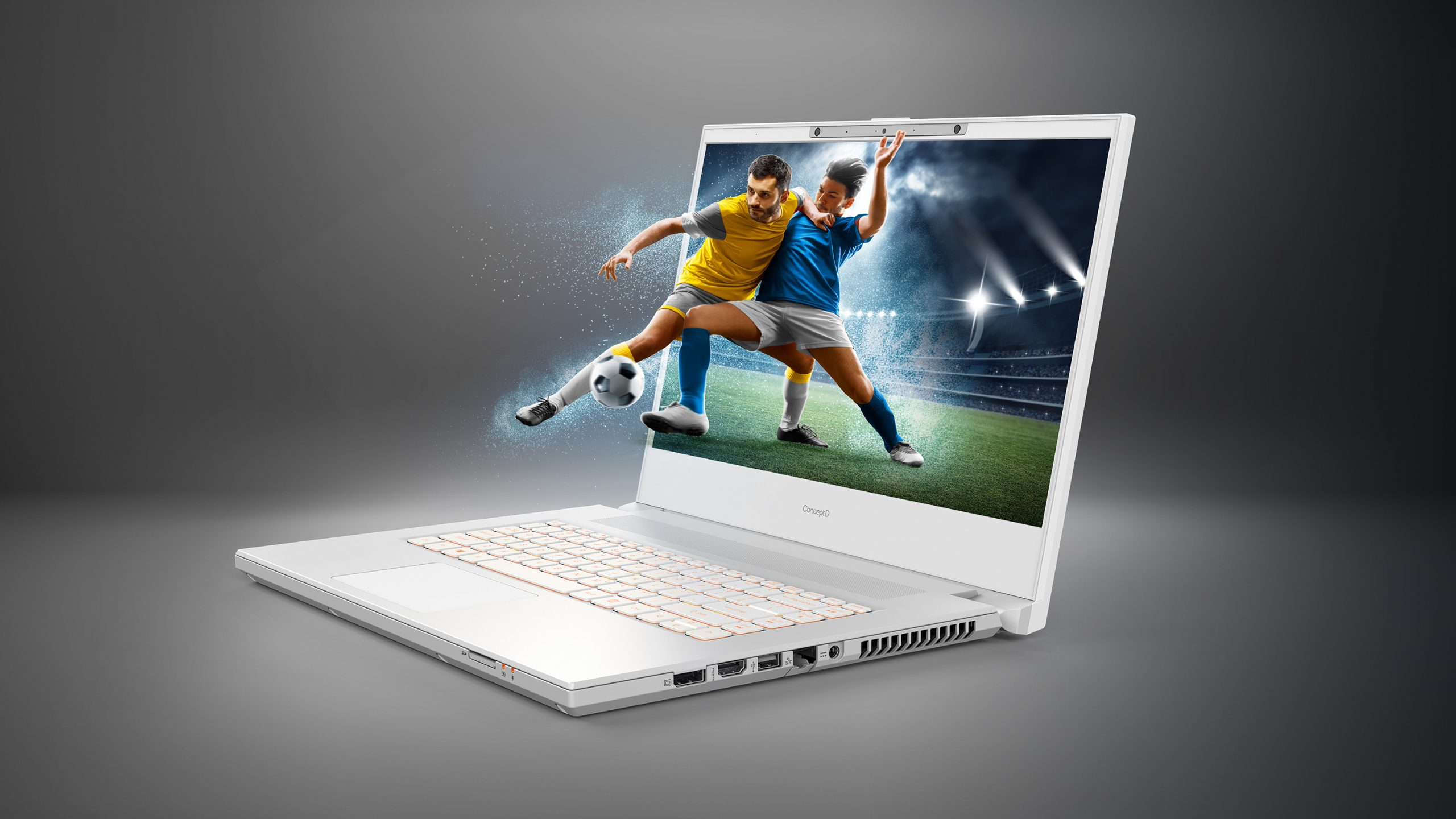 An Acer laptop with a 3D effect making the soccer players seem as if they are coming out of the screen