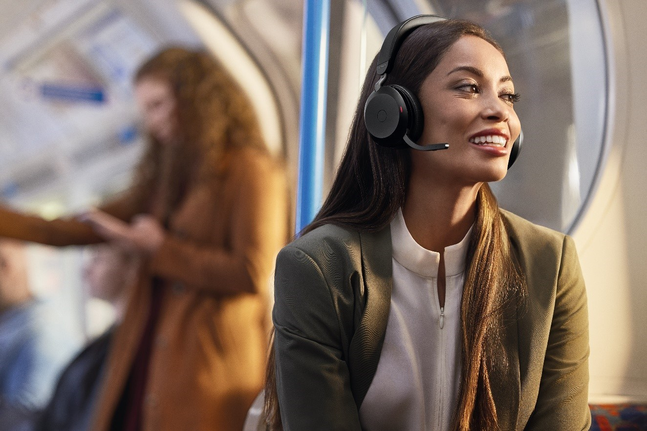 Remote work devices: A woman talking on the Jabra headset.