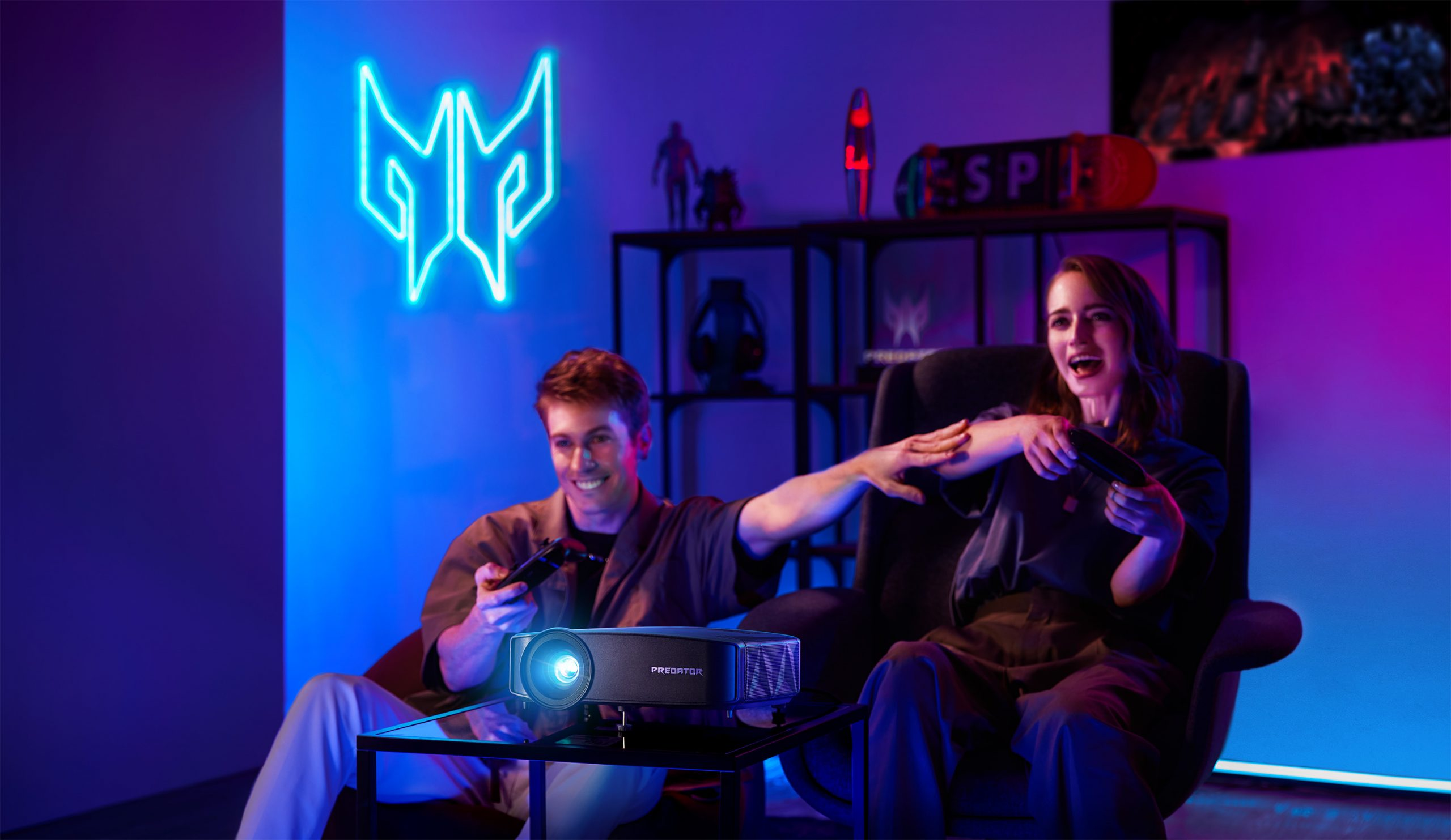 Two friends playing games using the Acer GD711 gaming projector